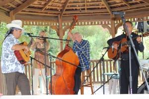 Mariashi Band serenades with Jim on bass and Olivia Newton John as the paparazzi